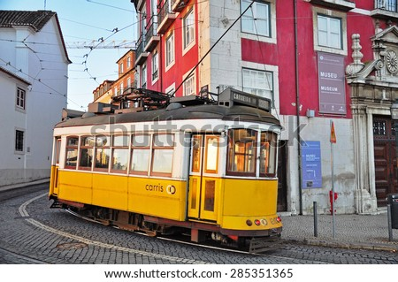 LISBON, PORTUGAL - DECEMBER 28: Yellow tram number 12 goes by the street of Lisbon city center on December 28, 2012. Lisbon is a capital and must famous city of Portugal