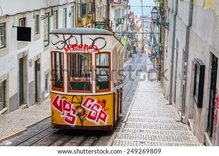 """Lisbon, Portugal, Europe - View from """"Bairro Alto"""" tramway street on a cloudy day with shadows of people passing (long Expo)  - stock photo"""