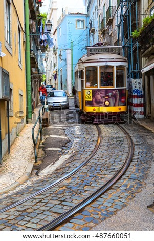 Lisbon, Portugal, 2016 05 06 - famous tram no 28 on the narrow street of Alfama