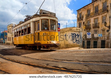 Lisbon, Portugal, 2016.05.06 - famous tram no 28 on the old street of Alfama