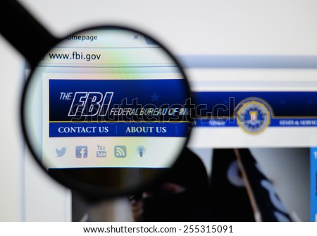 LISBON, PORTUGAL - February 24, 2015, 2014: Photo of the the fbi federal bureau of investigation page through a magnifying glass. - stock photo