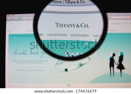 LISBON, PORTUGAL - FEBRUARY 3, 2014: Photo of Tiffany & Co. homepage on a monitor screen through a magnifying glass. - stock photo