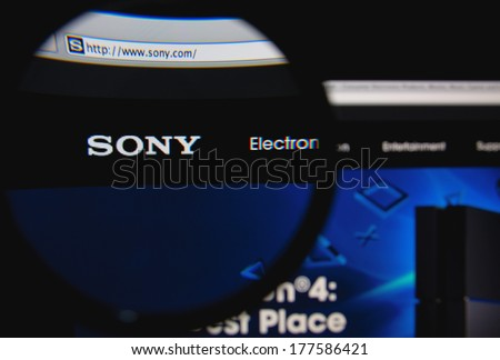 LISBON, PORTUGAL - FEBRUARY 19, 2014: Sony homepage through a magnifying glass. Sony diversified business is primarily focused on the electronics, game, entertainment and financial services sectors.