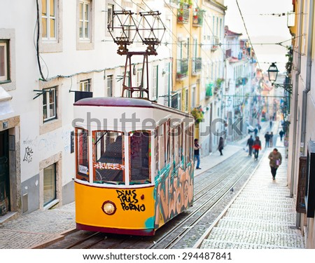 LISBON, PORTUGAL - JAN 15, 2015: Famous retro designed funicular in the Old Town street of Lisbon, Portugal - stock photo