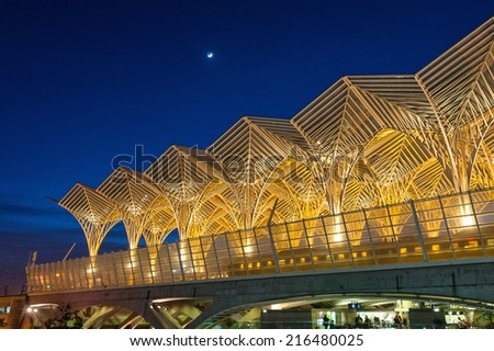 LISBON, PORTUGAL - JANUARY 4, 2014: Night view of Oriente Station. This Station was designed by Santiago Calatrava for the Expo '98 world's fair.  - stock photo
