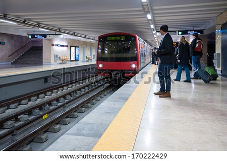 LISBON, PORTUGAL - JANUARY 1, 2014: People waiting for metro arriving. The Lisbon Metro opened in 1959, it was the first subway system in Portugal. It consists of 4 lines and 55 stations. - stock photo