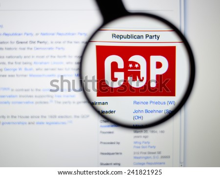 LISBON, PORTUGAL - January 4, 2015: Photo of Wikipedia article page about the Republican party on a monitor screen through a magnifying glass.  - stock photo