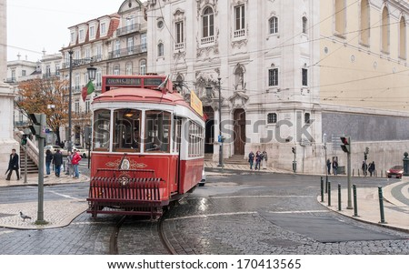 LISBON, PORTUGAL - JANUARY 2, 2014: Traditional tram in Largo de Chiado. The Lisbon tramway network is in operation since 1873, it presently comprises five urban lines.
