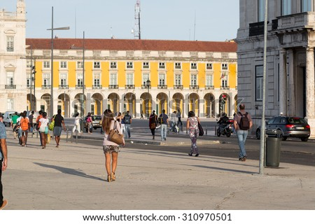 LISBON, PORTUGAL - JULY 8: People walking on Commercio Square, commuting to work after having left the ferry , on July 8, 2015 in Lisbon, Portugal. - stock photo