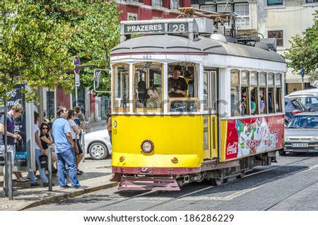 LISBON, PORTUGAL - JULY 28: Traditional yellow trams downtown Lisbon on July 28, 2013. Trams are used by everyone and also keep the traditional style of the historic center of Lisbon