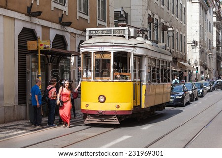 LISBON, PORTUGAL - JUNE 24: Old-fashioned yellow tram on June 24, 2014 in Lisbon, Portugal