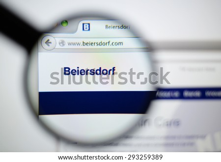 LISBON, PORTUGAL - June 6, 2015. Photo of Beiersdorf homepage on a monitor screen through a magnifying glass.