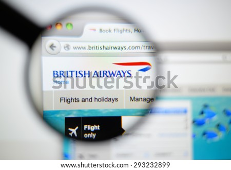 LISBON, PORTUGAL - June 6, 2015. Photo of British Airways homepage on a monitor screen through a magnifying glass. - stock photo