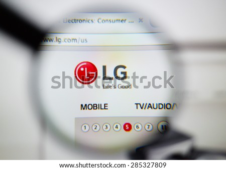 LISBON, PORTUGAL - June 6, 2015: Photo of: www.lg.com, lg (Lucky Goldstar) homepage on a monitor screen through a magnifying glass.