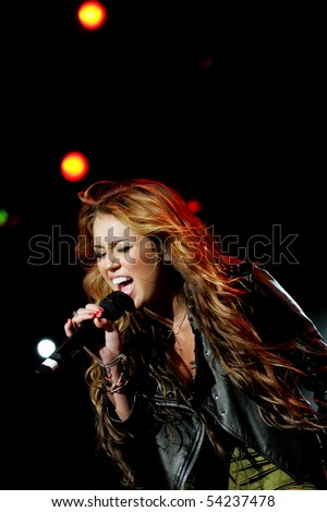 LISBON, PORTUGAL - MAY 29: Miley Cyrus performing on main stage on Rock in Rio - Lisboa May 29, 2010 in Lisbon, Portugal - stock photo