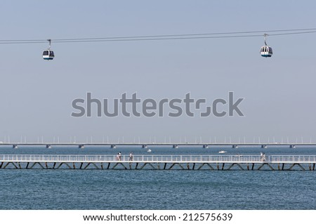 Lisbon, Portugal - May 15: The Cable Car and Vasco da Gama Bridge in Lisbon on May 15, 2014. The Cable Car provides an air trip over the whole of the Park of Nations. Portugal, Europe. - stock photo