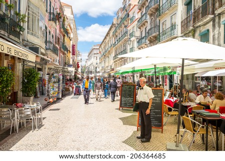 Lisbon, Portugal - MAY 26: Unidentified tourists are walking at Santo Antao street  on May 26, 2014 at Lisbon ,Portugal. Santo Antao is a lively pedestrian street known for its seafood restaurants. - stock photo