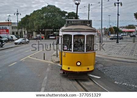 LISBON, PORTUGAL - NOV 10: Trams in Lisbon on Nov 10, 2013. Trams are especially useful in the narrow streets and also keep the traditional style of the historic centre of Lisbon.  - stock photo