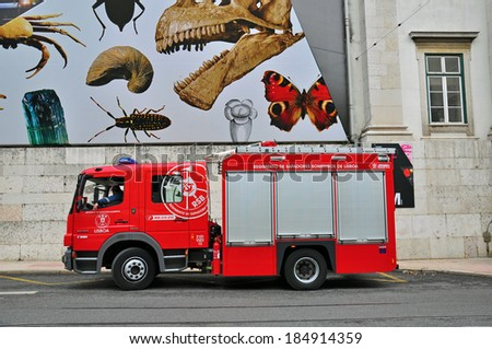 LISBON, PORTUGAL - NOVEMBER 23: Fire truck of the fire department of portuguese Bombeiros on November 23, 2012. fire apparatus is a vehicle designed to assist in firefighting and other operations. - stock photo