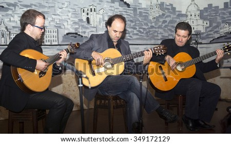 LISBON, PORTUGAL - NOVEMBER 23, 2010: Performing in a Lisbon cafe â??Lusoâ? - typical restaurant with fado and folklore - stock photo