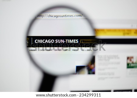 LISBON, PORTUGAL - NOVEMBER 30, 2014: Photo of Chicago Sun-Times homepage on a monitor screen through a magnifying glass.