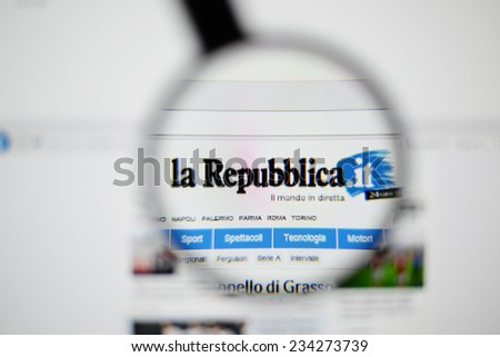 LISBON, PORTUGAL - NOVEMBER 30, 2014: Photo of La Repubblica homepage on a monitor screen through a magnifying glass.