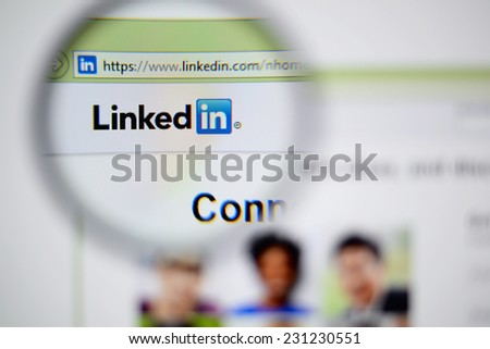LISBON, PORTUGAL - NOVEMBER 17, 2014: Photo of LinkedIn homepage on a monitor screen through a magnifying glass. - stock photo