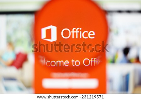 LISBON, PORTUGAL - NOVEMBER 17, 2014: Photo of Microsoft Office homepage on a monitor screen through a magnifying glass. - stock photo