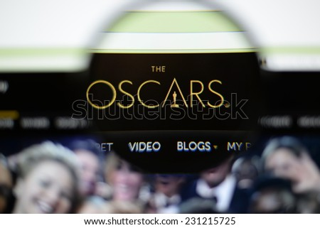 LISBON, PORTUGAL - NOVEMBER 17, 2014: Photo of the Academy Awards homepage on a monitor screen through a magnifying glass. - stock photo