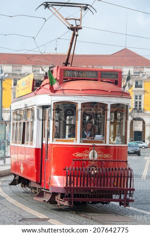 LISBON,PORTUGAL - OCT 25: Traditional tram at the Commerce square on October 25, 2013 in Lisbon, Portugal.The Lisbon tramway network operates since 1873.