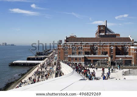 LISBON, PORTUGAL - October 5, 2016: Crowd on the roof of the MAAT (Museum of Art, Architecture and Technology), with the Electricity Museum in he background, in Lisbon, Portugal