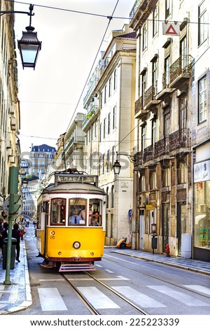 LISBON, PORTUGAL - OCTOBER 27 : Famous tram 28 line in the very center of Lisbon - vintage yellow tramway stops at the tram station on October 27th, 2013 - stock photo