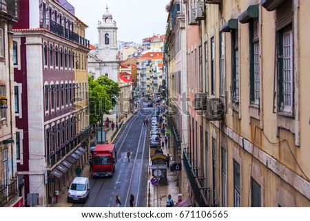 LISBON, PORTUGAL, on June 22, 2017. Historical buildings make attractive skyline in downtown. Cars and people move on the beautiful street