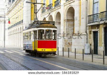 Lisbon, Portugal. Romantic Lisbon street with the typical yellow tram - stock photo