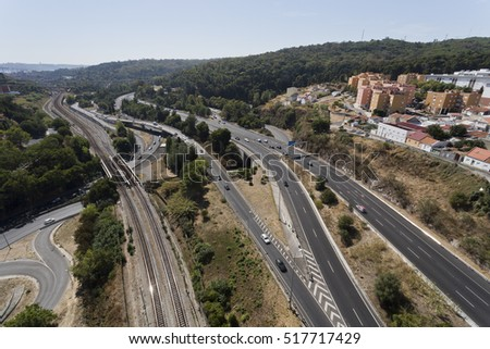 LISBON, PORTUGAL - September 30, 2016: View of the road and railway infrastructure in the Alcantara Valley towards the south of the Aqueduct of the Free Waters in Lisbon, Portugal