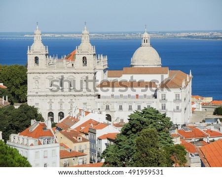 Lisbon, Portugal. Viewpoint Largo das Portas do Sol, a balcony opens onto the river offering truly spectacular views over Alfama. Lookout on the Monastery of Sao Vincente  de Flora