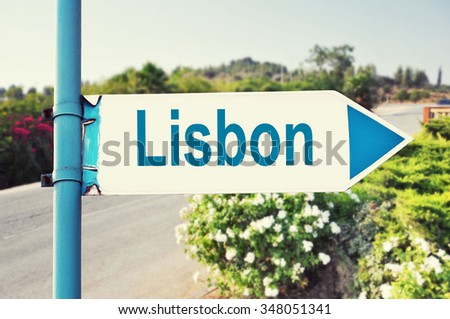 Lisbon Road Sign with beautiful nature and road on background - stock photo