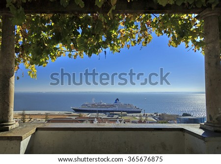 Lisbon roofs and cruise ship in harbor, view from vine arc