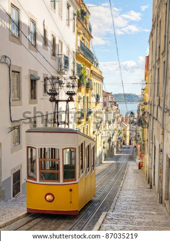 Lisbon's Gloria funicular classified as a national monument opened 1885 located on the west side of the Avenida da Liberdade connects  downtown with Bairro Alto. - stock photo