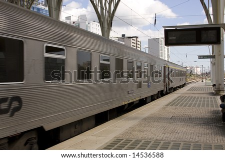 Lisbon train station with train in motion - stock photo