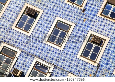 Lisbon windows. Wall with blue title and windows