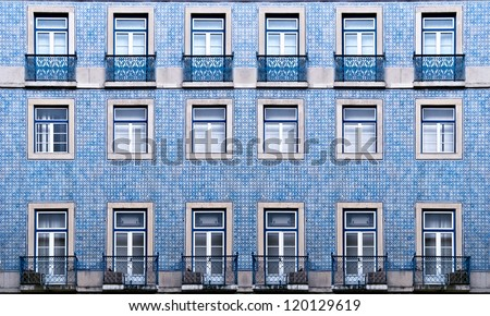 Lisbon windows with typical portuguese tiles on the wall - stock photo