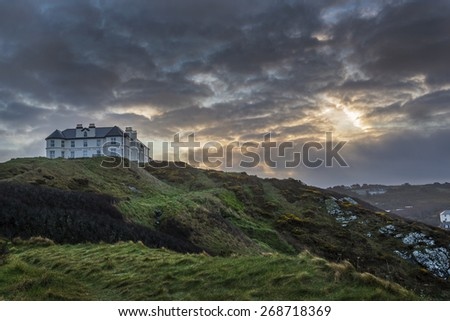 Liskeard, United Kingdom, 12 April 2015. A photo taken at sunrise of the Mullion Cove Hotel at Mullion, Cornwall, UK, a beautiful Cornish holiday destination visited by people the world over.