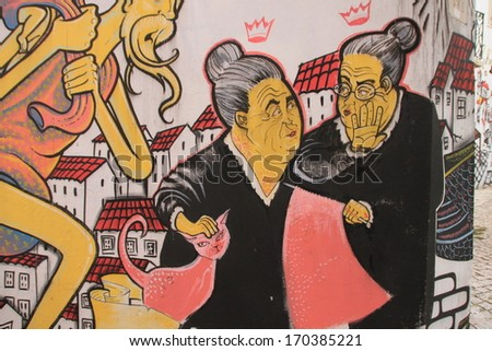 Lissabon, Portugal, November 1, 2013:Anonymous graffiti image shows the talking portuguese grandmother concerning with knitting. Graffiti is located in old city.  - stock photo
