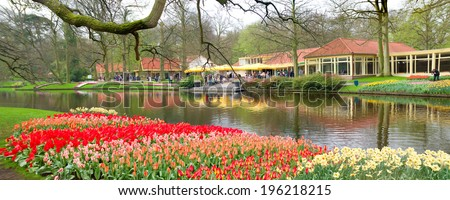 LISSE, NETHERLANDS - APRIL 6, 2014: Tulip gardens in the Keukenhof. Keukenhof is the world's largest flower garden with 900,000 visitors a year