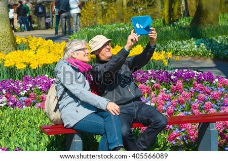LISSE, THE NETHERLANDS, APRIL 11, 2016: Tourists are visiting 'the Keukenhof' in the spring. It is a popular flower garden which is visited by a million tourists from all around the world every year.