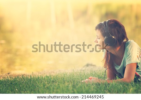 Listen to the music in the park - stock photo
