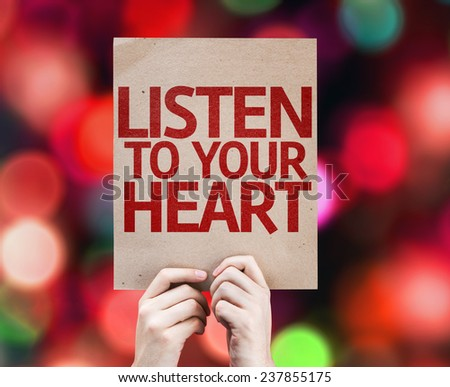 Listen To Your Heart card with colorful background with defocused lights - stock photo