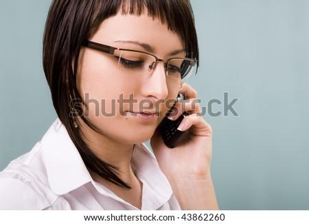Listening on the phone. Shot in studio. - stock photo