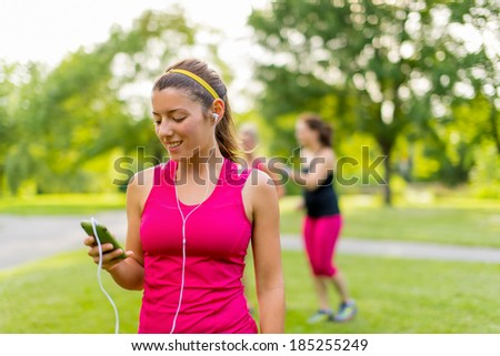 listening to music helps her workout - stock photo